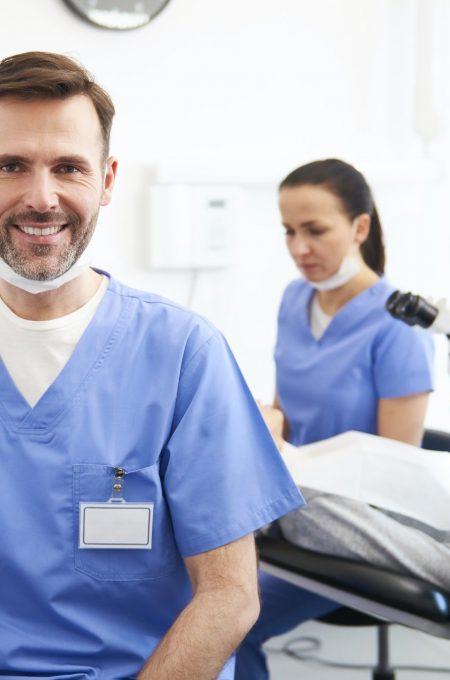 portrait-of-smiling-male-dentist-in-dentist-s-clinic.jpg